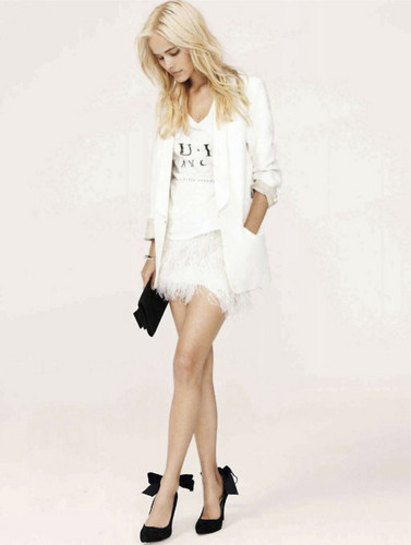 DemolitionVenom wallpaper containing a well dressed person and a playsuit titled Isabel Lucas