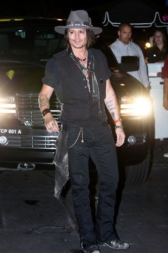 Johnny Depp wallpaper containing a business suit, a well dressed person, and a hip boot called Johnny at Aerosmith Concert Afterparty - Aug. 6 2012