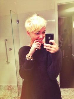 Miley says goodbye to the bun, debuts new haircut