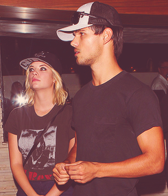 Taylor Lautner with Ashley Benson at the Red O Mexican Restaurant in L.A