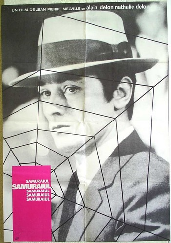 Alain Delon wallpaper containing a chainlink fence titled