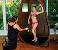 Gets A Spray Tan At The Scedka Colada Beach House [6 August 2012] - carmen-electra photo