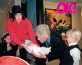 Good Friend, Bill, Getting Acquainted With Michael's Newborn Son, Michael II (Blanket) - michael-jackson photo