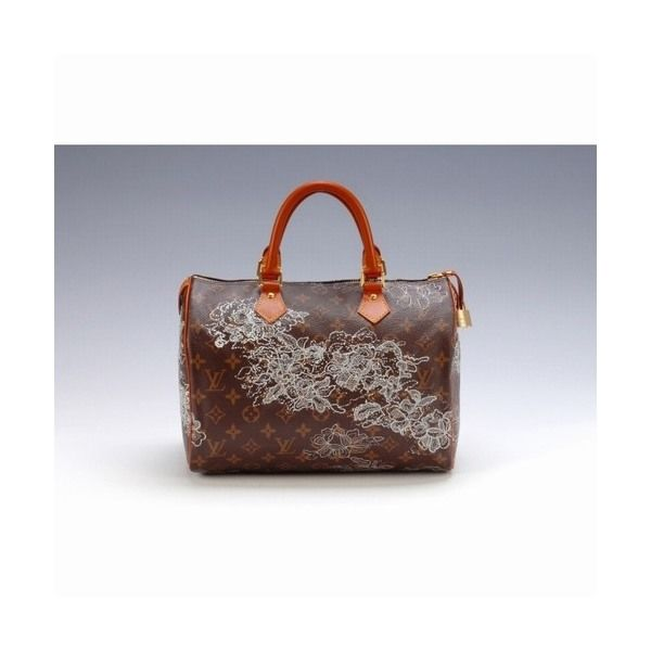 Lady Gaga's Fashion Louis Vuitton Monogram Dentelle Speedy 30 handbag  - 600 x 600  26kb  jpg