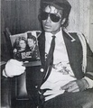 Michael reading about himself - michael-jackson photo