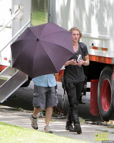 Jamie Campbell Bower Обои possibly containing a parasol called On the set of 'The Mortal Instruments: City of Bones' (August 20, 2012)