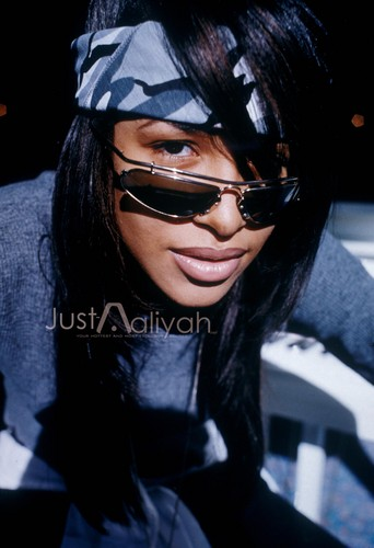 Aaliyah wallpaper possibly with sunglasses titled Aaliyah Exclusive! Just-Aaliyah.Net