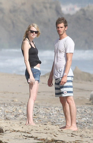 Andrew & Emma kissing on the beach