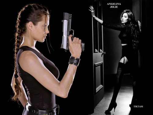 Angelina Jolie wallpaper probably containing a hip boot and a legging entitled Angelina <3