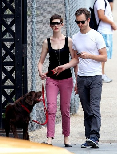 Anne Hathaway wallpaper possibly containing a chainlink fence titled Anne Hathaway and Adam Shulman Go for a Walk [August 25, 2012]