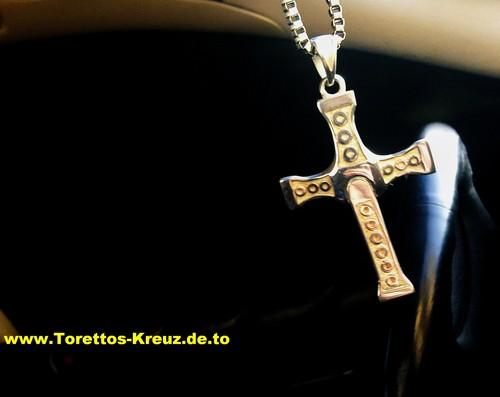Dom Torettos menyeberang, cross