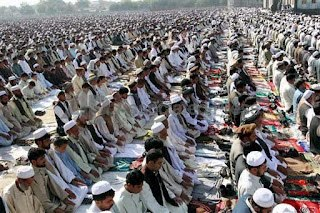 MUSLIMS 壁紙 probably with a 自動車道, 車道 titled Eid prayers from all over the world