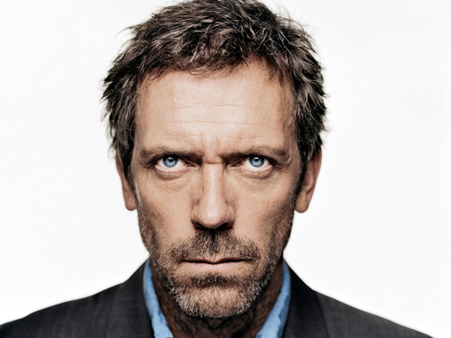 Hugh Laurie wallpaper containing a business suit, a suit, and a judge advocate called Hugh Laurie