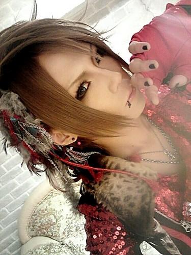 Royz achtergrond probably with a portrait titled Kazuki