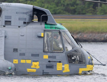 Prince William pilots a military helicopter as part of a demonstration in July, 2011
