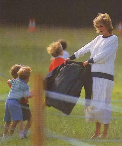 Princess Diana playing with Prince Harry