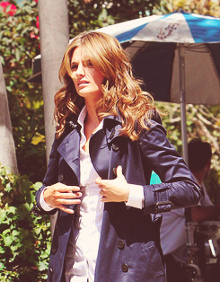 Stana Katic karatasi la kupamba ukuta possibly with a business suit titled Stana Katic {New ngome S5 Behind the Scenes}