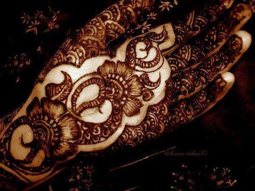 mehendi wallpaper possibly containing a conch called mehandi....