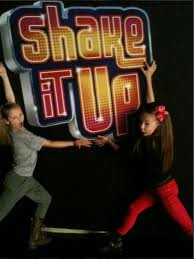 sophia lucia and autmn miller in front of shake it up sign