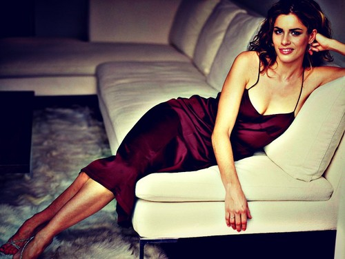 Amanda Peet wallpaper probably with a couch, bare legs, and tights titled AmandaP