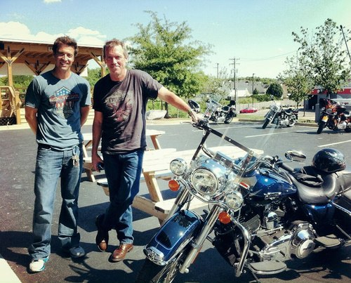 Hugh Laurie wallpaper with a motorcycle cop titled Hugh Laurie visits Man O' War Harley-Davidson in Lexington, Kentucky