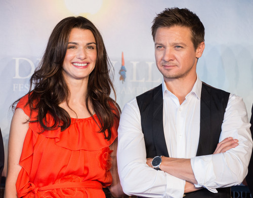 Jeremy Renner wallpaper probably with a business suit, a well dressed person, and a dress suit titled Rachel Weisz and Jeremy Renner at Deauville, France
