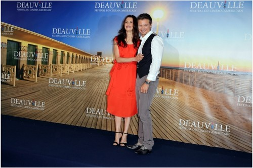 Jeremy Renner wallpaper possibly containing a cocktail dress called Rachel Weisz and Jeremy Renner at Deauville, France