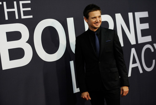 Jeremy Renner wallpaper with a business suit entitled jeremy renner @world premiere of the bourne legacy