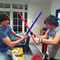 Fighting with lightsabers.