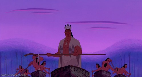 Which tribe had Powhatan and his warriors just defeated when they returned home at the beginning of Pocahontas?