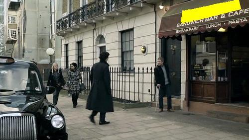 What's the name of the sandwich bar that can be seen right next to 221B?