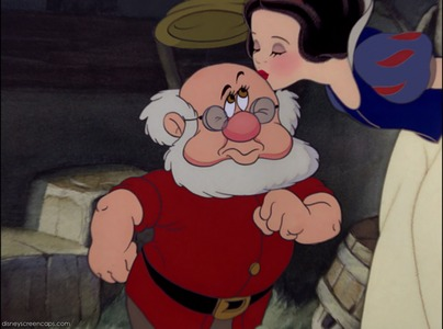 Who is not kissed por Snow White before the dwarfs go mining?