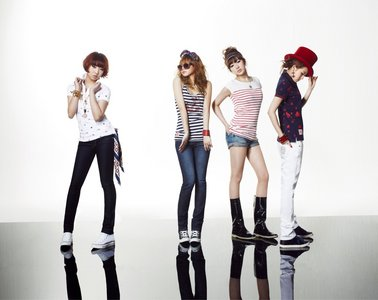 Who debuted as an actress in the Philippines before joining 2NE1?
