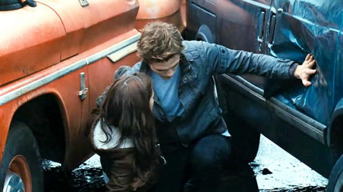 Who came around the car to see if Bella was okay after Edward left?
