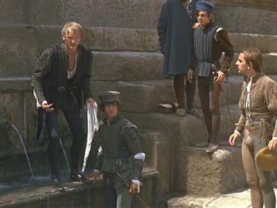 """In a Public Place, Mercutio becomes angry with Tybalt, and yells out to him, """"Tybalt, you ________, will you walk?"""""""