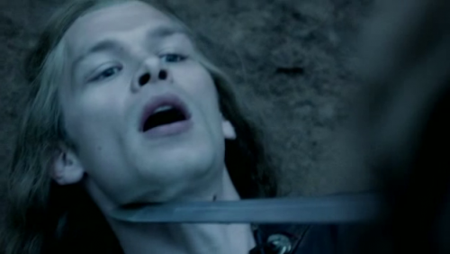 who pointed the sword at klaus's neck?