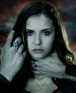 Who's got the hand on Elena's hair?