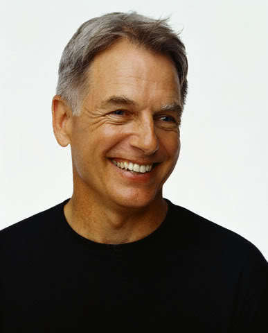What year did Mark Harmon save two young men from a burning car?