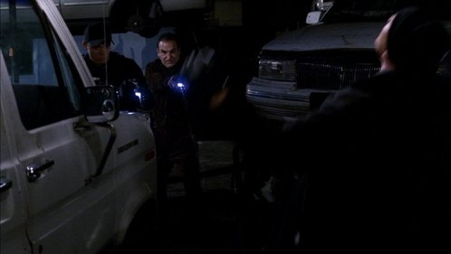 In 1x08 Natural Born Killer what finally takes the unsub down when he is choking Hotch: