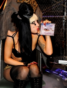 Is this photo of Lady Gaga kissing Katy's CD real?