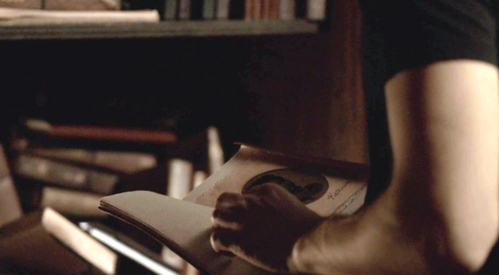 Stefan with a photo of Katherine from 1864 in what episode from season one?