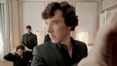 (S02E01 A Scandal in Belgravia) What Sherlock says to indicate danger before he opens Irene Adler's safe?