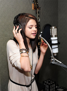 Who has wrote Selena Gomez's first song?