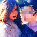 Who's in this picture with Demi?