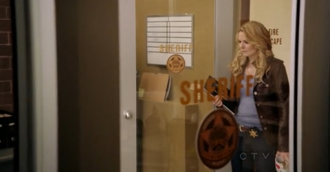 What item of Graham's does Emma find in the Sheriff's office at the end of 1x08?