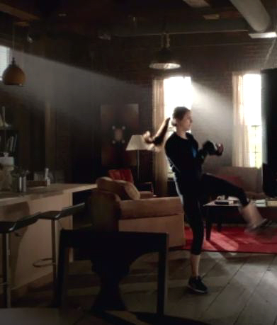 Who finds Elena working out in this scene?