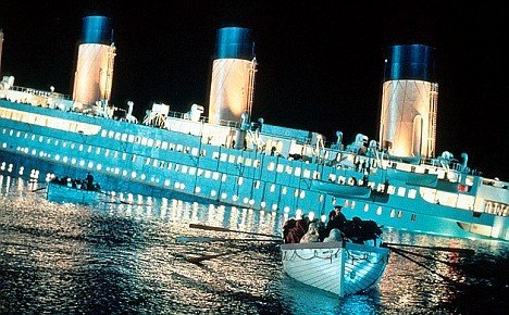 In this image, what line of portholes has the waterline reached?
