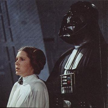 Does Princess Leia ever forgive her fallen and redeemed father Lord Vader?