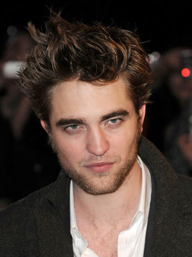 Which of Robert Pattinson's acting parts ended up on the cutting room floor, but later appeared in the DVD as an alternative ending?