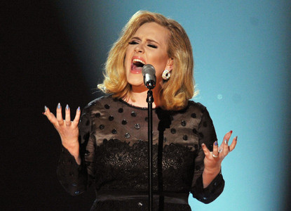 Which song did Adele perform at the 54th Annual Grammy Awards?